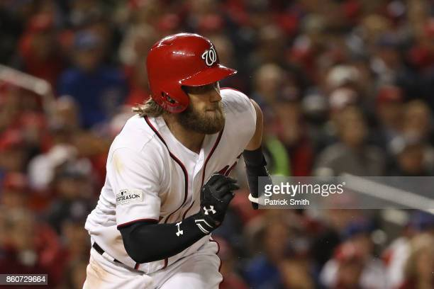 Bryce Harper of the Washington Nationals hits a double against the Chicago Cubs during the sixth inning in game five of the National League Division...