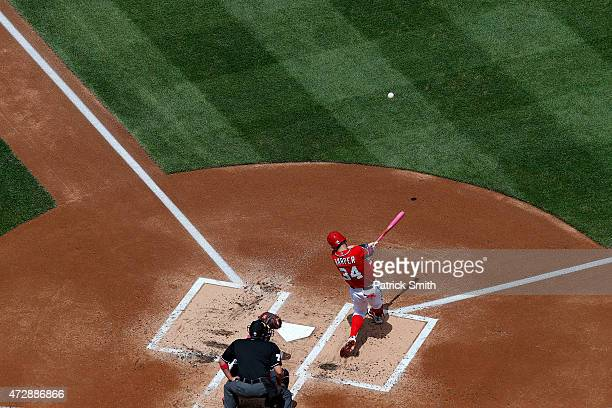 Bryce Harper of the Washington Nationals hits a double in the first inning against the Atlanta Braves at Nationals Park on May 10 2015 in Washington...