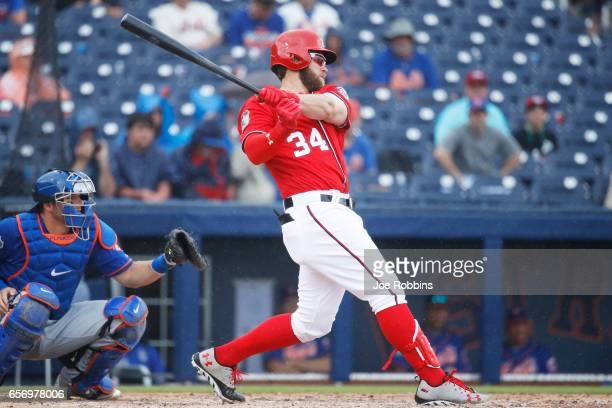 Bryce Harper of the Washington Nationals hits a double to lead off the sixth inning of a Grapefruit League spring training game against the New York...