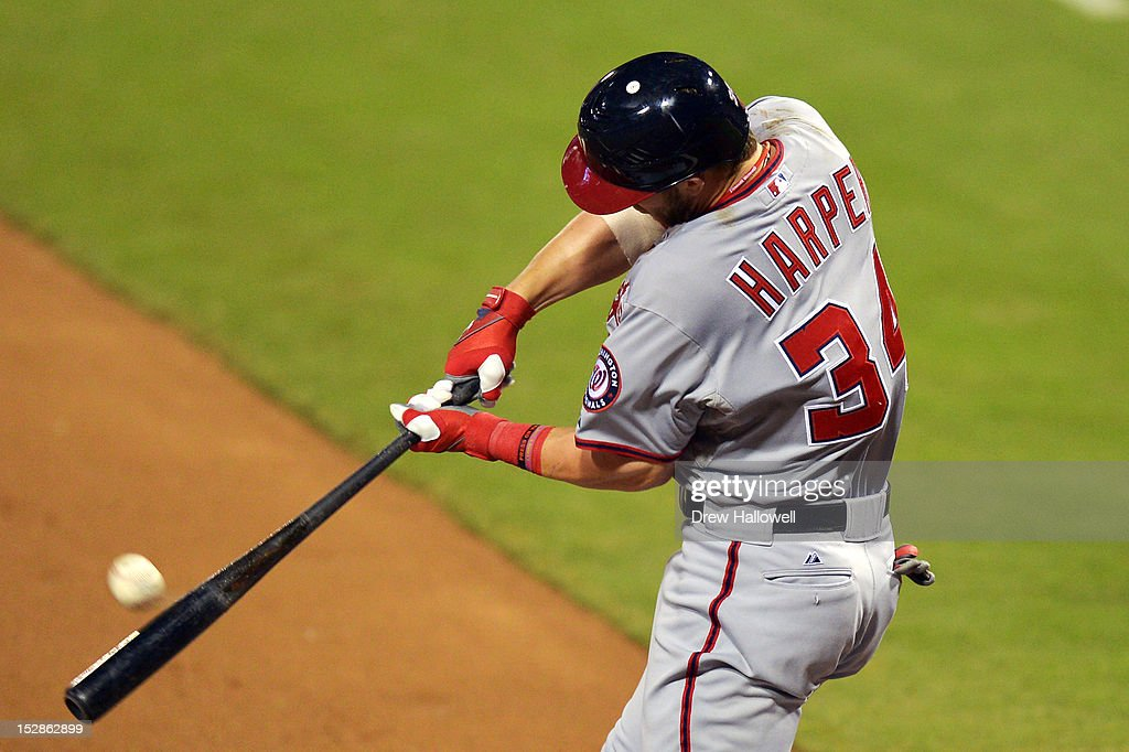 Bryce Harper #34 of the Washington Nationals hits a home run in the first inning against the Philadelphia Phillies at Citizens Bank Park on September 27, 2012 in Philadelphia, Pennsylvania.