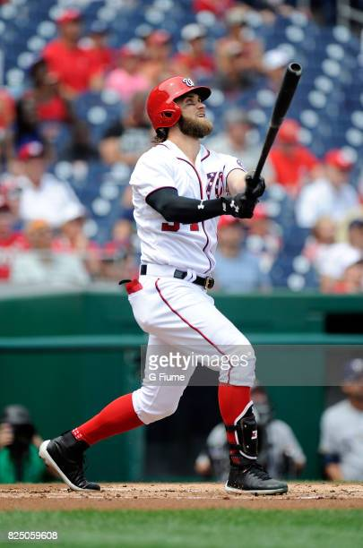 Bryce Harper of the Washington Nationals hits a home run in the first inning against the Milwaukee Brewers at Nationals Park on July 27 2017 in...
