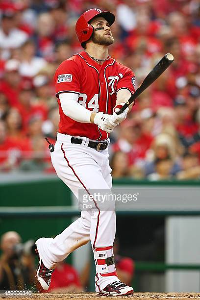 Bryce Harper of the Washington Nationals hits a home run in the seventh inning against the San Francisco Giants during Game One of the National...