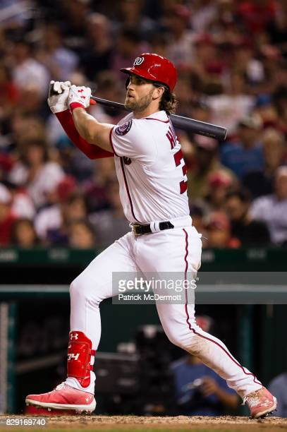 Bryce Harper of the Washington Nationals hits a RBI sacrifice fly to left scoring Brian Goodwin in the sixth inning during a game against the Miami...