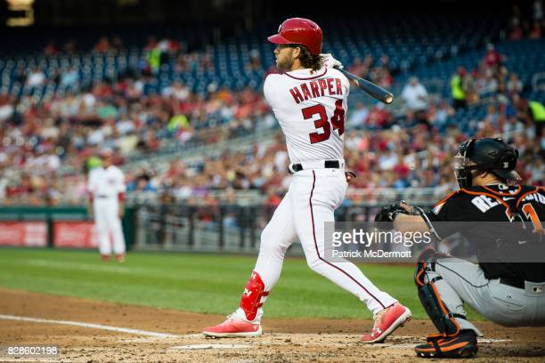 Bryce Harper of the Washington Nationals hits a RBI single scoring Brian Goodwin in the third inning during a game against the Miami Marlins at...