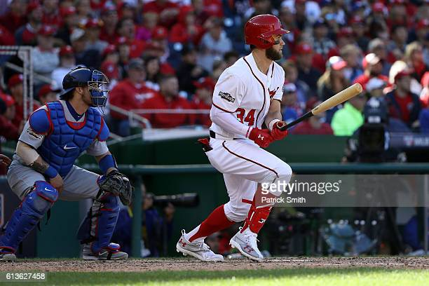 Bryce Harper of the Washington Nationals hits a single against the Los Angeles Dodgers in the fifth inning during game two of the National League...