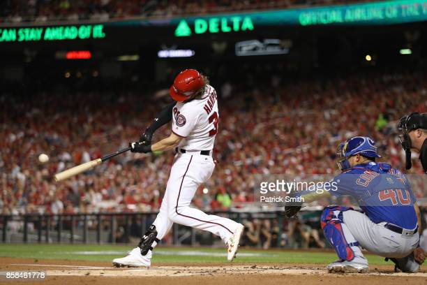 Bryce Harper of the Washington Nationals hits a single against the Chicago Cubs in the first inning during game one of the National League Division...