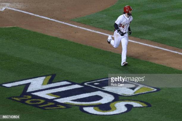 Bryce Harper of the Washington Nationals hits a single against the Chicago Cubs during the fourth inning in game five of the National League Division...