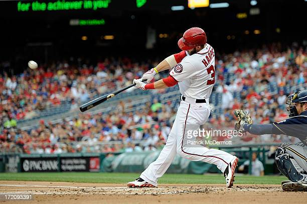 Bryce Harper of the Washington Nationals hits a solo home run in the first inning during a game against the Milwaukee Brewers at Nationals Park on...