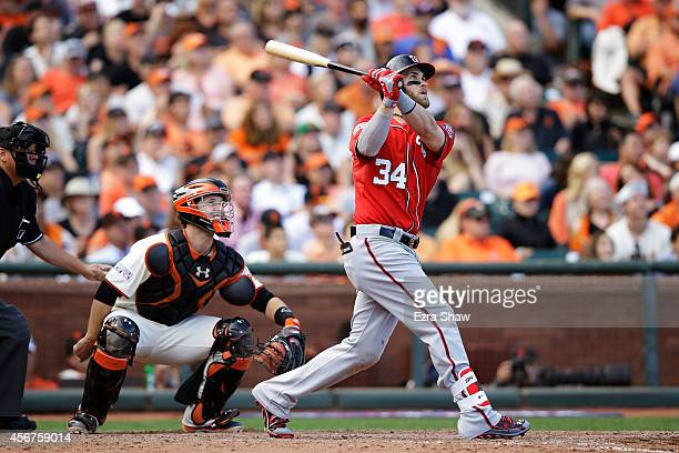 Bryce Harper of the Washington Nationals hits a solo home run in the ninth inning against the San Francisco Giants during Game Three of the National...