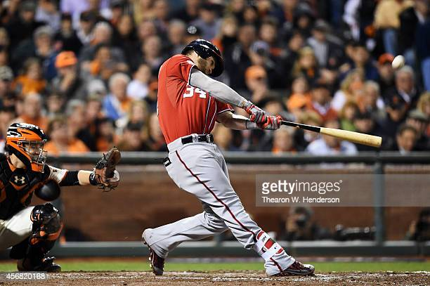 Bryce Harper of the Washington Nationals hits a solo home run in the seventh inning against the San Francisco Giants during Game Four of the National...