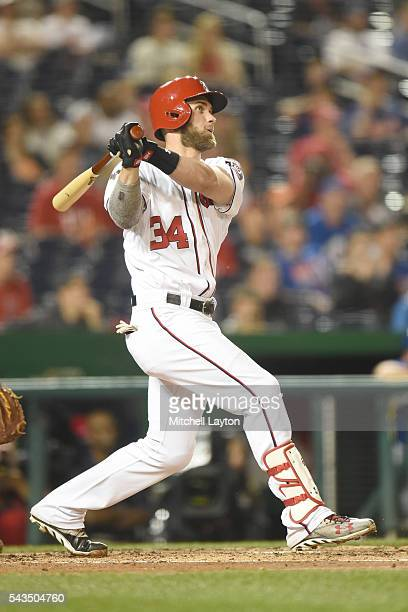 Bryce Harper of the Washington Nationals hits a two run home run in the fifth inning during a baseball game against the New York Mets at Nationals...