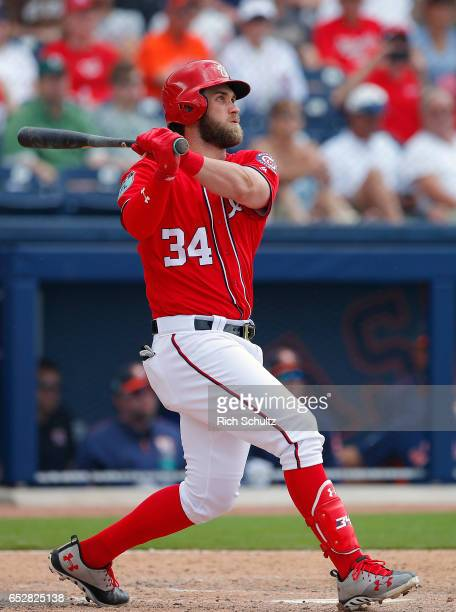 Bryce Harper of the Washington Nationals hits a two run home run during the fifth inning against the Houston Astros during a spring training baseball...