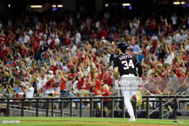 Bryce Harper of the Washington Nationals hits a tworun home run in the second inning against the Philadelphia Phillies at Nationals Park on May 4...