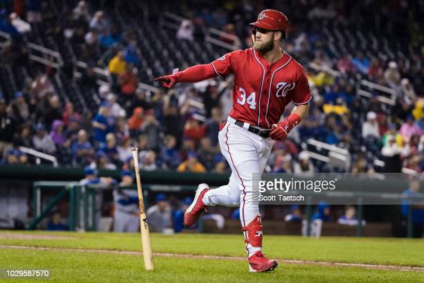 Bryce Harper of the Washington Nationals hits a tworun home run against the Chicago Cubs during the seventh inning of game two of a doubleheader at...