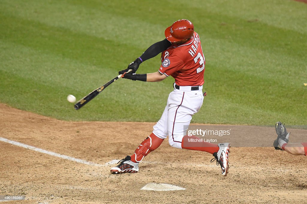 Bryce Harper #34 of the Washington Nationals hits a walk off double in the 12th inning during a baseball game against the Philadelphia Phillies at Nationals Park on September 26, 2015 in Washington, DC. The Nationals won 2-1 in the 12th inning.