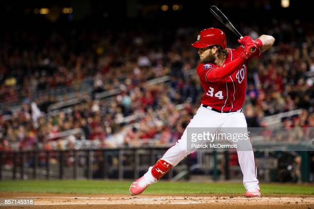 Bryce Harper of the Washington Nationals hits against the Pittsburgh Pirates in the first inning at Nationals Park on September 30 2017 in Washington...