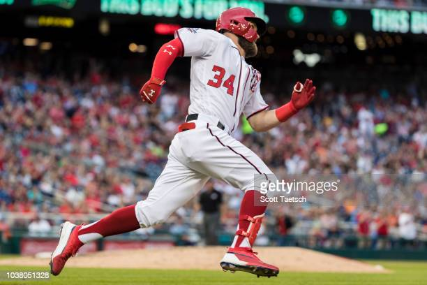 Bryce Harper of the Washington Nationals hits an RBI double against the New York Mets during the seventh inning at Nationals Park on September 22...