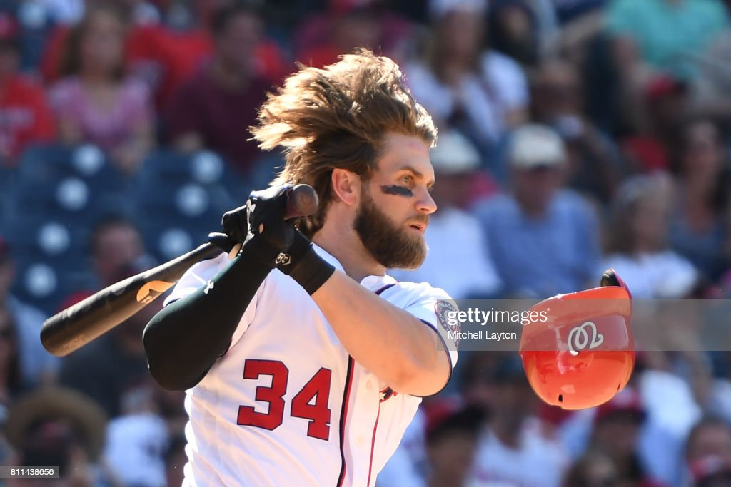 Bryce Harper #34 of the Washington Nationals hits an RBI single in the eighthinning during a baseball game against the Atlanta Braves at Nationals Park on July 9, 2017 in Washington, DC. The Nationals won 10-5.