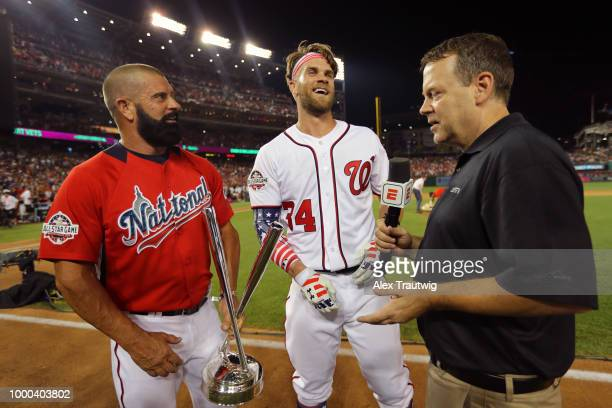 Bryce Harper of the Washington Nationals interviews with Buster Onley after winning the TMobile Home Run Derby at Nationals Park on Monday July 16...