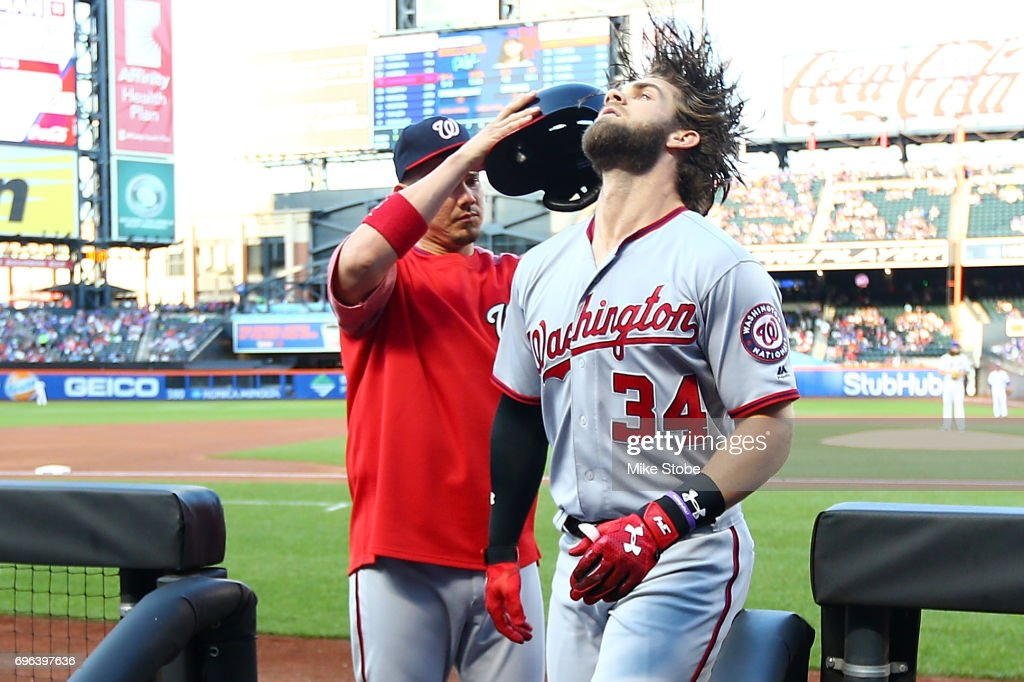 Bryce Harper #34 of the Washington Nationals is congratulated after hitting a first inning solo home run against the New York Mets at Citi Field on June 15, 2017 in the Flushing neighborhood of the Queens borough of New York City.