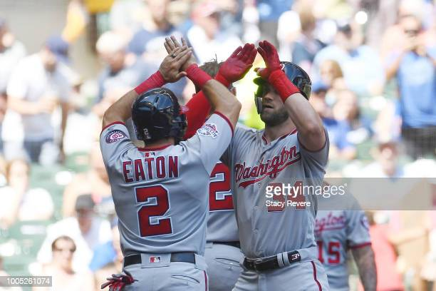 Bryce Harper of the Washington Nationals is congratulated by Adam Eaton following a threerun home run against the Milwaukee Brewers during the fifth...