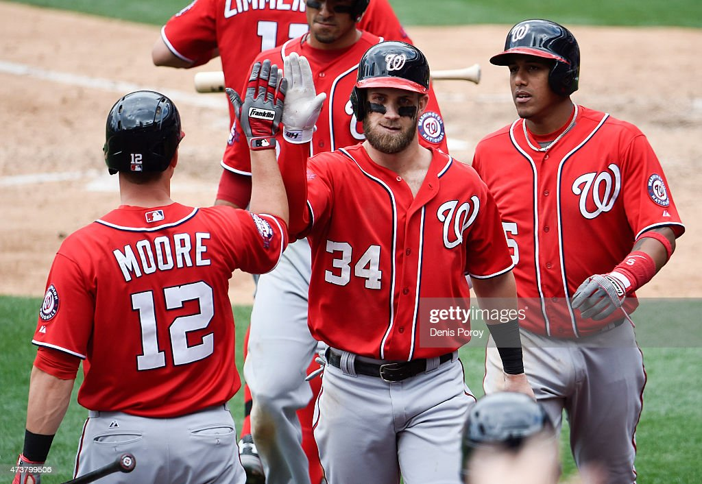 Bryce Harper #34 of the Washington Nationals is congratulated by Tyler Moore #12 and Yunel Escobar #5 after he hit a three-run home run during the seventh inning of a baseball game against the San Diego Padres at Petco Park May 17, 2015 in San Diego, California.