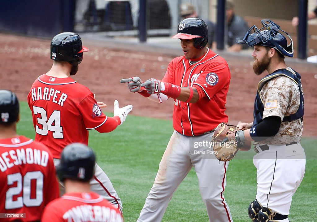 Bryce Harper #34 of the Washington Nationals is congratulated by Yunel Escobar #5 after he hit a three-run home run as Derek Norris #3 of the San Diego Padres looks on during the seventh inning of a baseball game at Petco Park May 17, 2015 in San Diego, California. The Nationals won 10-5.
