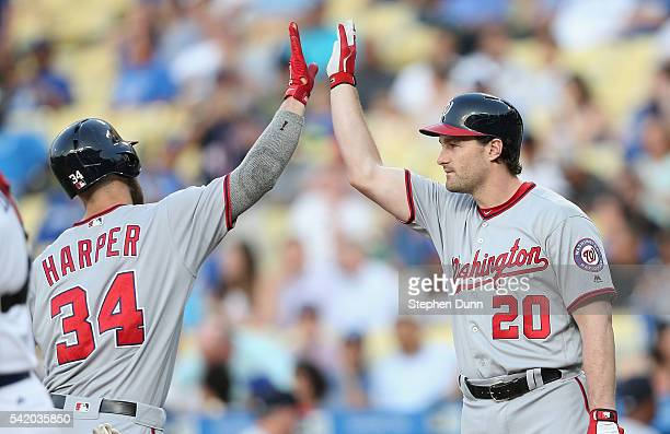 Bryce Harper of the Washington Nationals is greeted by ondeck batter Daniel Murphy after scoring on his solo home run in the first inning against the...