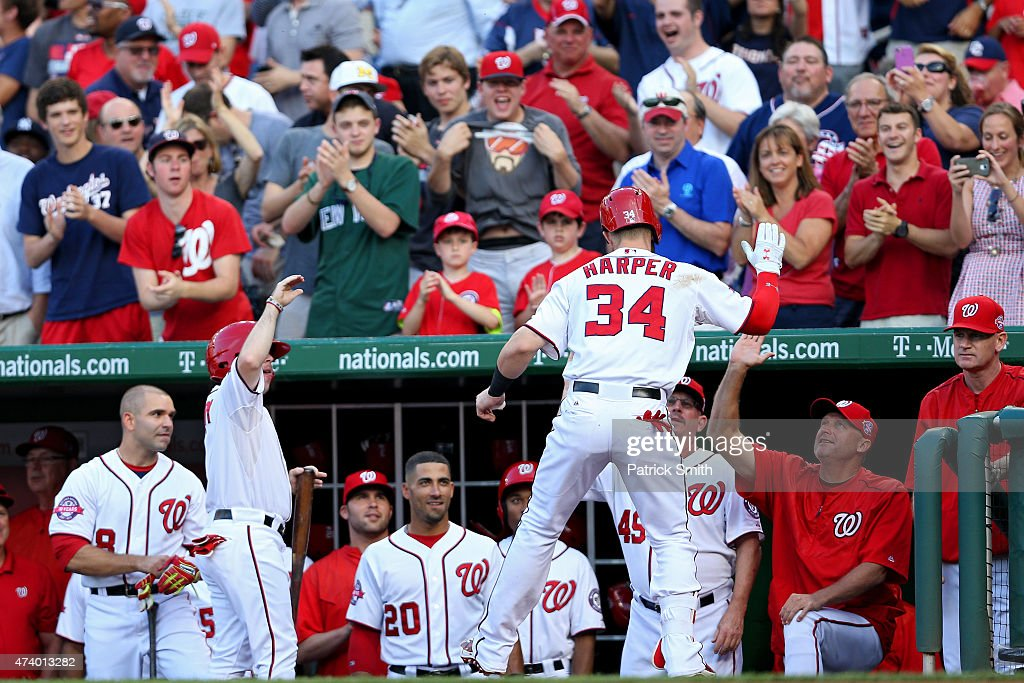 Bryce Harper #34 of the Washington Nationals is greeted in the dugout after hitting a home run against the New York Yankees in the first inning at Nationals Park on May 19, 2015 in Washington, DC.