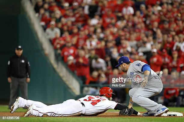 Bryce Harper of the Washington Nationals is picked off at first base by Adrian Gonzalez of the Los Angeles Dodgers for the third out of the fifth...