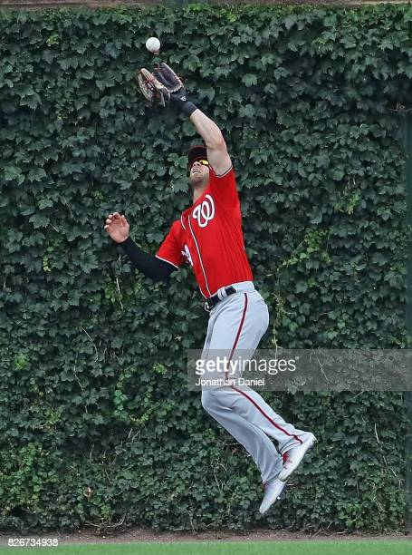 Bryce Harper of the Washington Nationals leaps to make a catch of a fly ball hit by Jon Jay of the Chicago Cubs in the 5th inning at Wrigley Field on...
