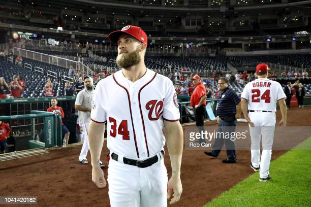 Bryce Harper of the Washington Nationals looks around at the crowd following the Nationals 93 win over the Miami Marlins at Nationals Park on...