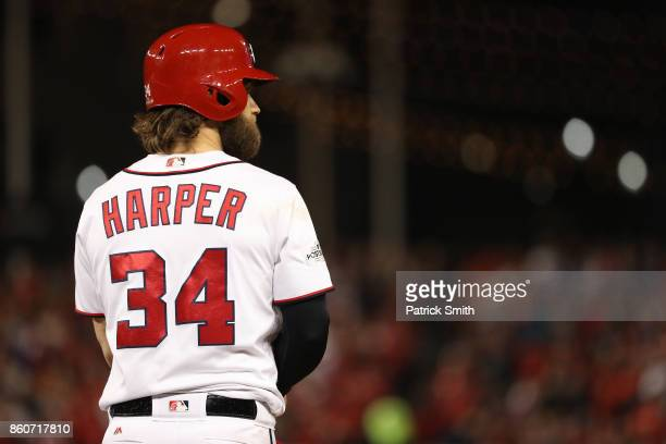 Bryce Harper of the Washington Nationals looks on after hitting a single against the Chicago Cubs during the fourth inning in game five of the...