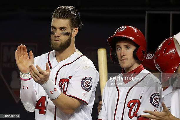 Bryce Harper of the Washington Nationals looks on against the Los Angeles Dodgers during the third inning in game one of the National League Division...