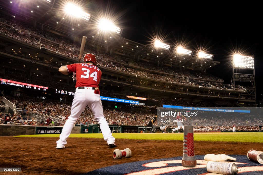 Bryce Harper #34 of the Washington Nationals looks on from the batters circle against the Miami Marlins during the sixth inning at Nationals Park on July 07, 2018 in Washington, DC.