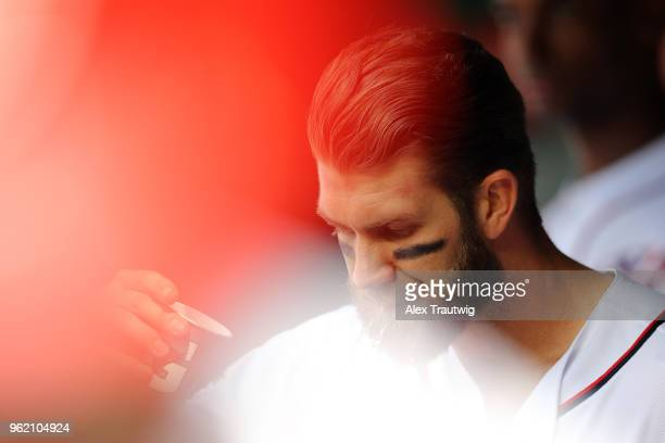 Bryce Harper of the Washington Nationals looks on from the dugout during a game against the San Diego Padres at Nationals Park on Wednesday May 23...