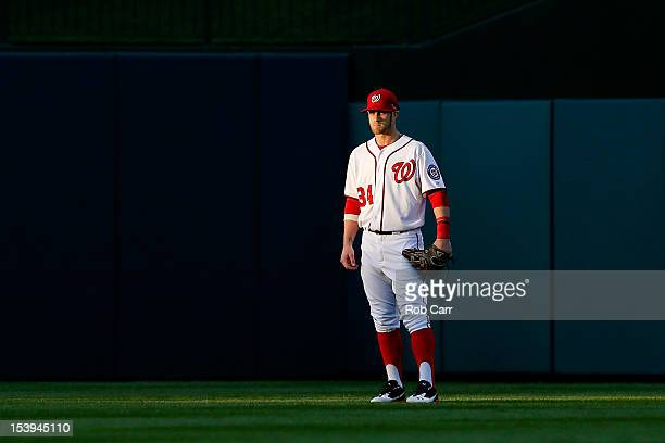 Bryce Harper of the Washington Nationals looks on from the outfield against the St Louis Cardinals during Game Four of the National League Division...