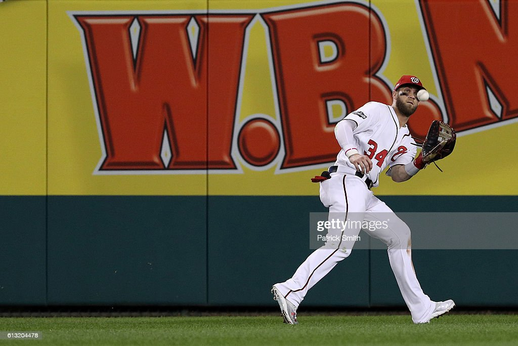 Bryce Harper #34 of the Washington Nationals makes a catch for the first out of the fifth inning against the Los Angeles Dodgers in game one of the National League Division Series at Nationals Park on October 7, 2016 in Washington, DC.