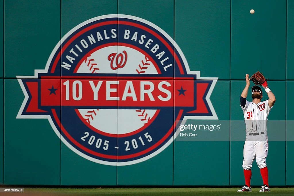 Bryce Harper #34 of the Washington Nationals makes a catch in the outfield against the New York Mets during Opening Day at Nationals Park on April 6, 2015 in Washington, DC.