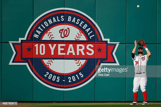 Bryce Harper of the Washington Nationals makes a catch in the outfield against the New York Mets during Opening Day at Nationals Park on April 6 2015...