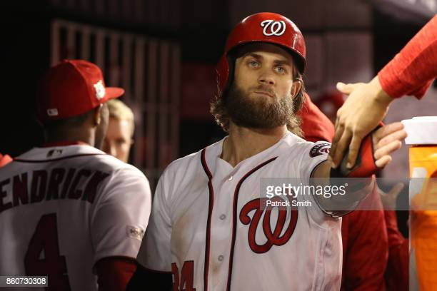 Bryce Harper of the Washington Nationals of the Washington Nationals celebrates after scoring against the Chicago Cubs during the sixth inning in...