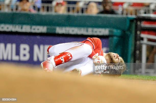 Bryce Harper of the Washington Nationals on the ground in pain after injuring his leg in the first inning against the San Francisco Giants at...