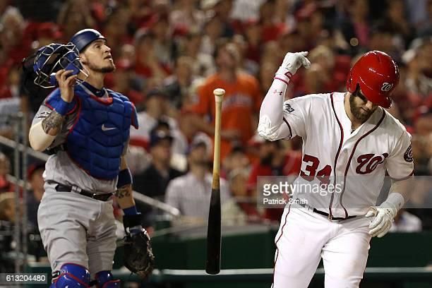 Bryce Harper of the Washington Nationals pops out for the third out of the fourth inning against the Los Angeles Dodgers in game one of the National...