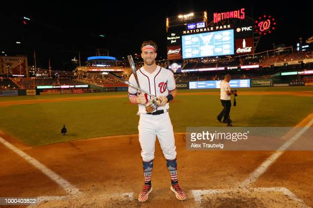 Bryce Harper of the Washington Nationals poses with the home run derby trophy after winning the TMobile Home Run Derby at Nationals Park on Monday...