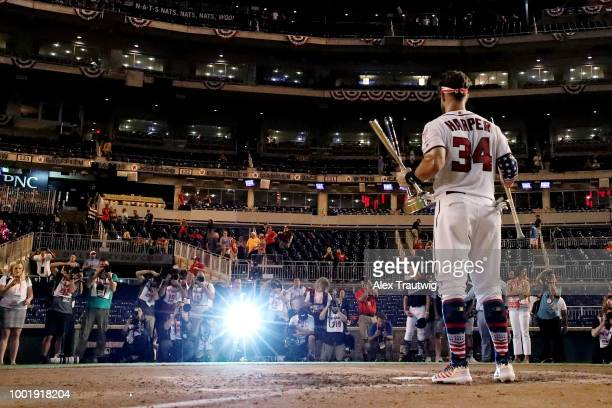 Bryce Harper of the Washington Nationals poses with the trophy after winning the TMobile Home Run Derby at Nationals Park on Monday July 16 2018 in...