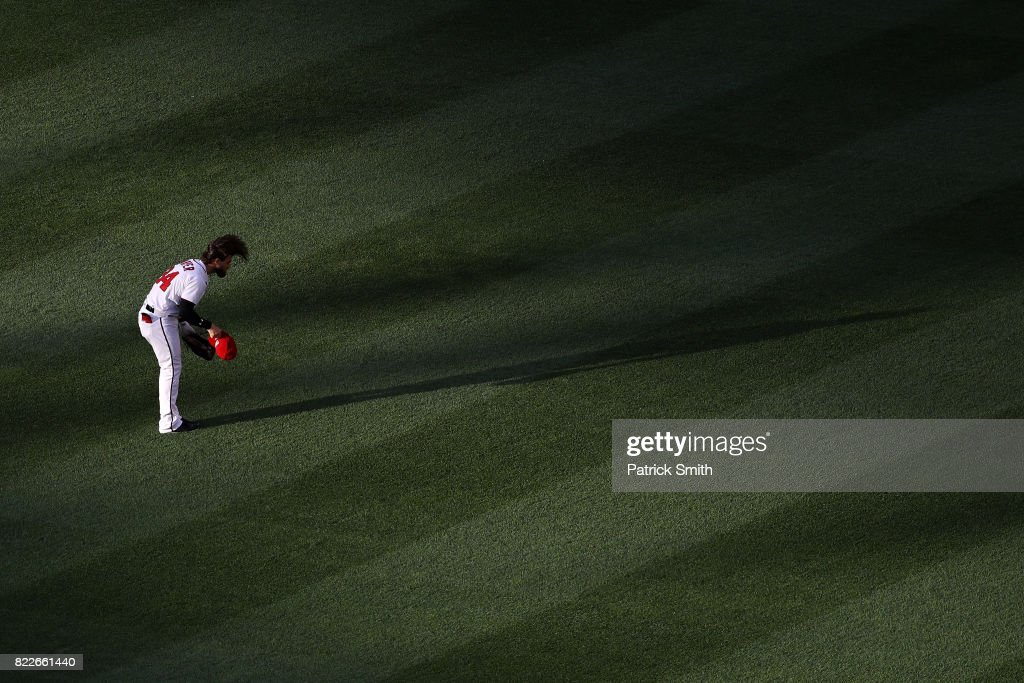 Bryce Harper #34 of the Washington Nationals puts his hat on before playing against the Milwaukee Brewers at Nationals Park on July 25, 2017 in Washington, DC.