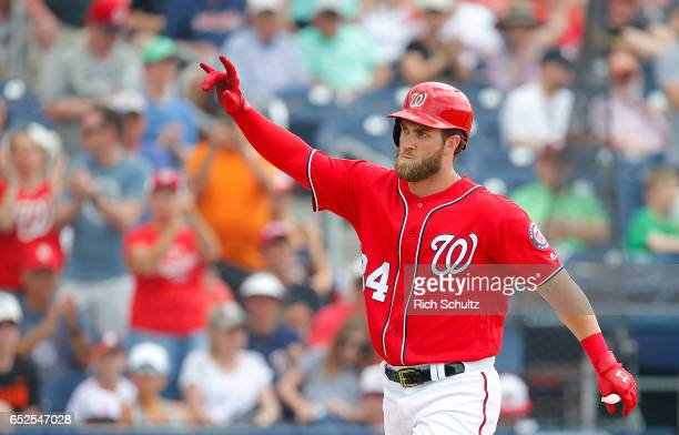 Bryce Harper of the Washington Nationals reacts after he hit a two run home run during the fifth inning against the Houston Astros during a spring...