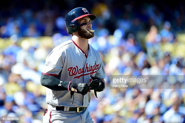 Bryce Harper of the Washington Nationals reacts after he walks in the first inning against the Los Angeles Dodgers in game three of the National...