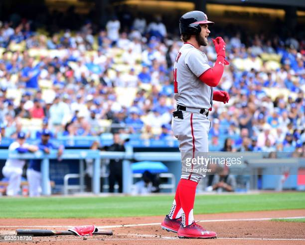 Bryce Harper of the Washington Nationals reacts after his strikeout to end the first inning against the Los Angeles Dodgers at Dodger Stadium on June...