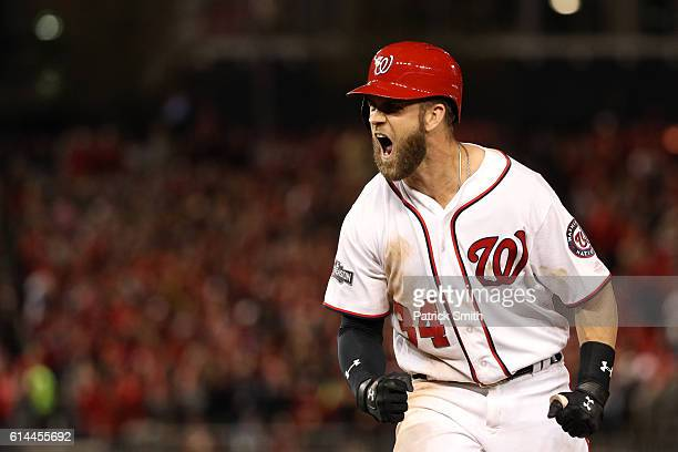 Bryce Harper of the Washington Nationals reacts after hitting a single in the seventh inning against the Los Angeles Dodgers during game five of the...